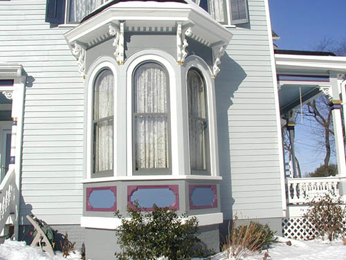 Historical Storm Windows With Arched Glass